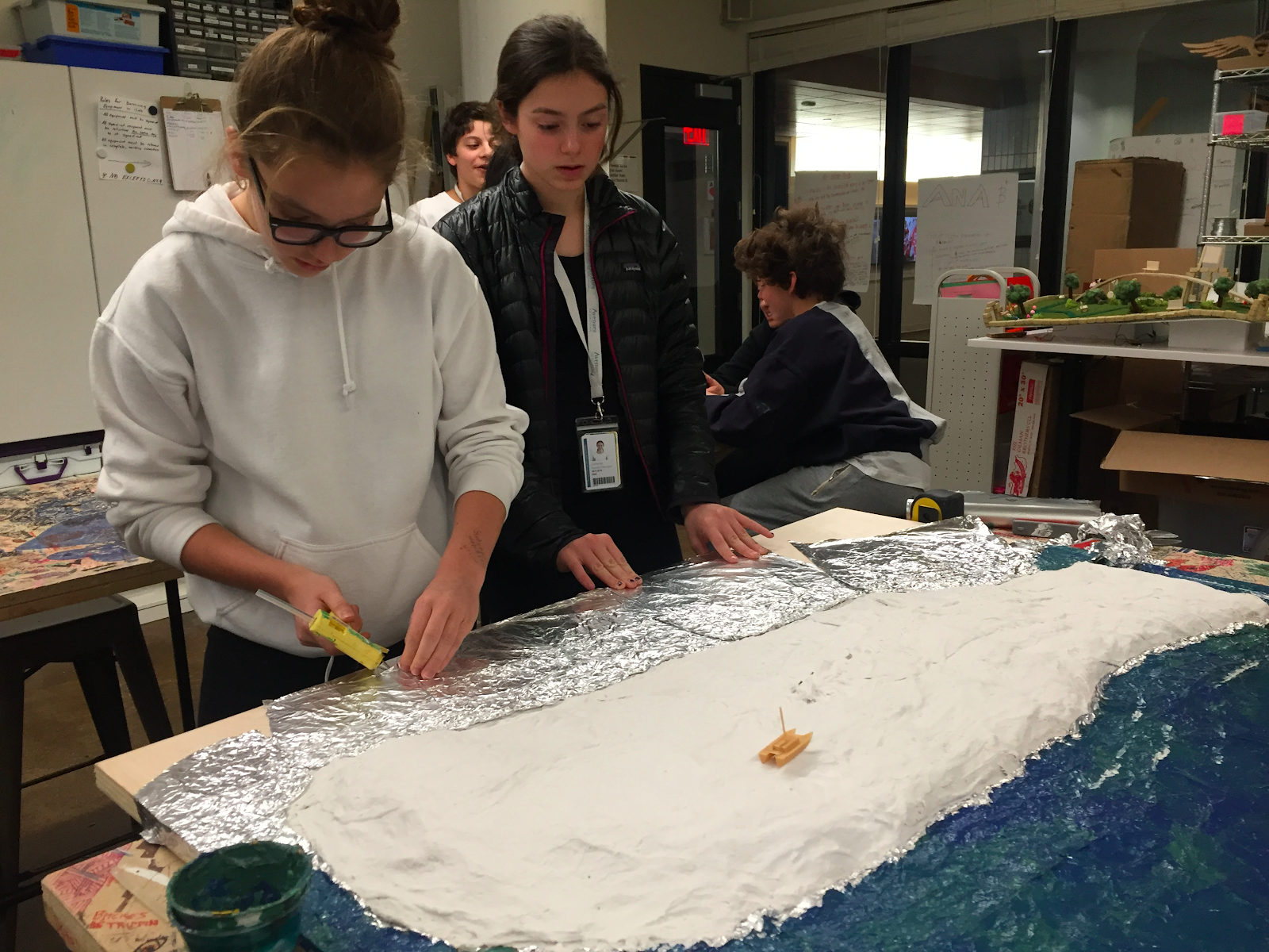 "Students create ""water"" around their island."