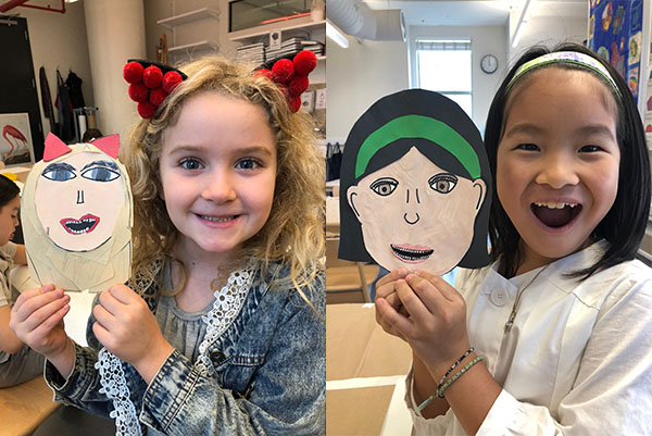 Students with their laughing self portraits